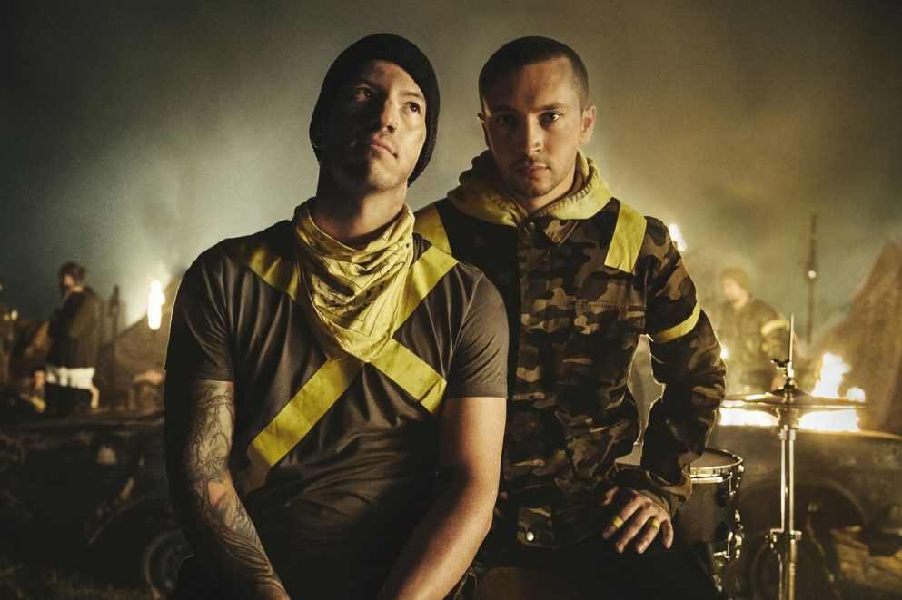 Twenty One Pilots have an unexpected time at the pool in their new video for 'Chlorine'